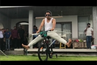 Ms dhoni filmed performing bizarre cycling stunt