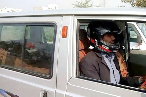 Indian traffic cops fine man for not wearing helmet while driving car