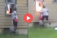 Woman filmed setting fire to home with residents inside